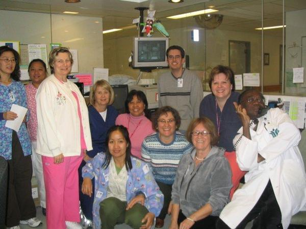 Group photo at work! -I am the one on the left beside the Drs. hand!